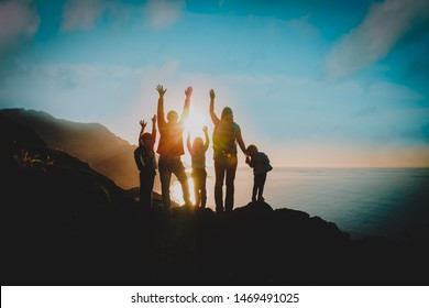 big family with kids travel in mountains at sunset