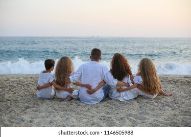 Big family on vocation. Happy Family sitting sea. famaly, travel, tour concept.