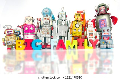 Big Family of robots with thw words BIG FAMILY with wooden letters
