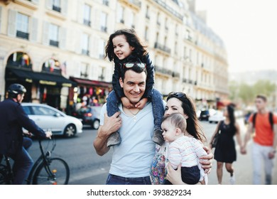 Big family walking the streets in Paris