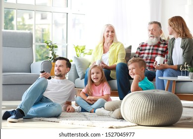 Big family watching TV together at home