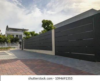The big fence and private modern houses on the streets in Rishon LeZion, Israel. Close up shot