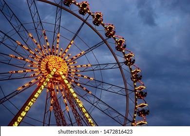 big ferris wheel on a background of cloudy sky. beautiful