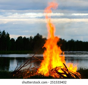 a big fire at a lake shore on Midsummer Day, Finland