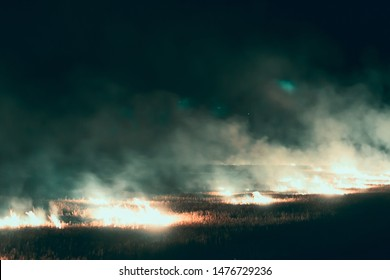 Big fire and a lot of thick smoke. Fire at night