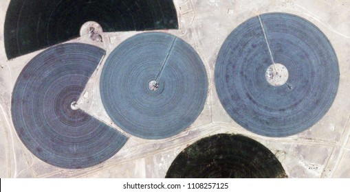 the big fish eats the little one, farms of human crops, in the desert, tribute to Pollock, abstract photography of the deserts of Africa from the air, aerial view, contemporary photographic art,