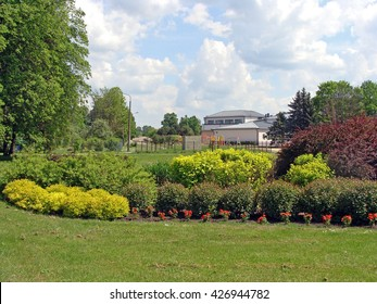 Big flower bed with decorative plants in the park.