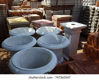 Big flowerpots displayed in a wooden rack.Garden shop with stone and ceramic flowerpots.Flowerpot in store.