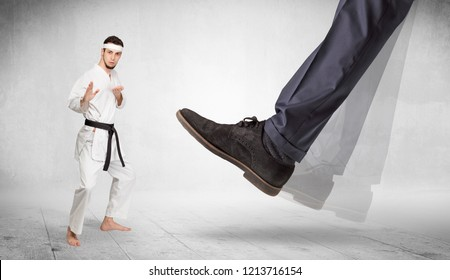 Big foot trample young karate trainer concept