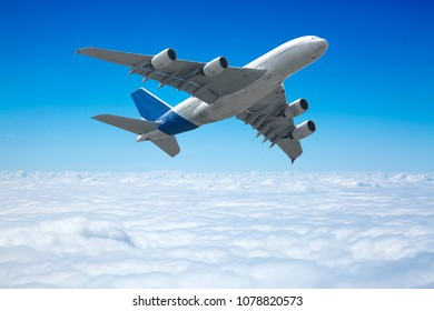 Big four engine plane on the sky with clouds. Aircraft on long intercontinental flights.