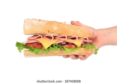 Big fresh sandwich in hands. Isolated on a white background.