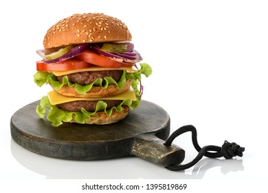 Big fresh tasty burger on wooden board  isolated on white background