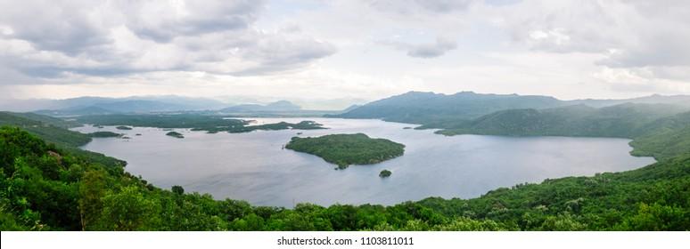 Big fresh water lake Slansko Jezero between green mountains in Montenegro