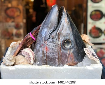 Big frozen head of bluefin tuna or toro maguro, street fish market in japan