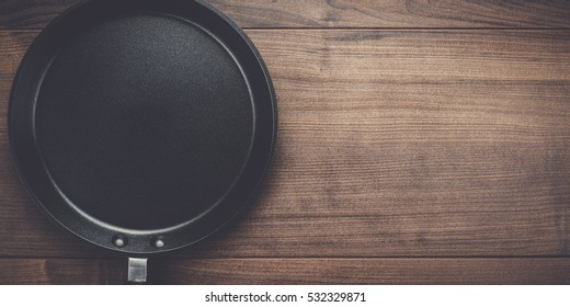 big frying pan on the table background