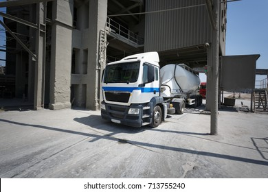 A big fuel tanker. White truck on asphalt road. Transportation theme. Road cars theme.