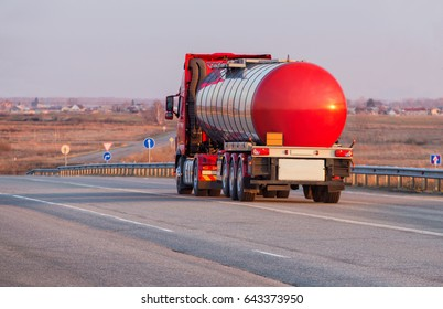 big fuel truck goes on the country highway