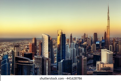 Big futuristic city at colorful sunset. Fantastic skyline of Dubai, UAE.