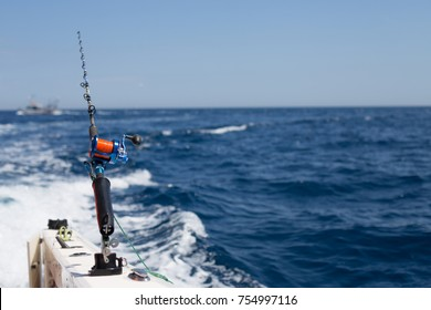 Big game fishing. Tuna caching in  Mediterranean.  Close-up of a fishing reel on the boat. Fishing rod in sea.