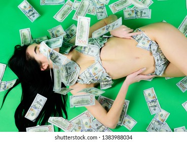 big game. money girl on green background. business success. investment in yourself. body trade. dollar bikini fashion. perfect body and hair. sexy woman in summer swimsuit in currency. big fish.