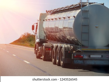 Big gas-tank goes on highway against the sky