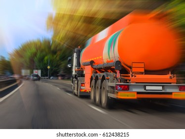 big gas-tank truck goes on highway against the sky