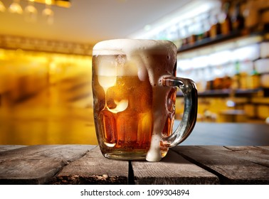 A big glass of beer on counter bar in restaurant