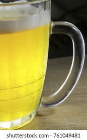 big glass of golden beer close-up