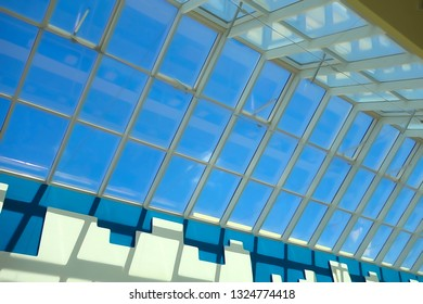 Big glass roof and blue sky on a sunny day
