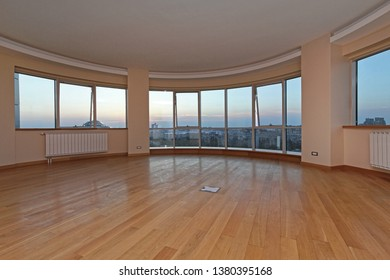 Big Glass Wall in Oval Living Room With Cityscape View Penthouse