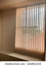 Big glass window vertical simple blinds view