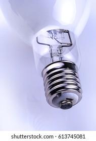 Big glowing light bulb on white background