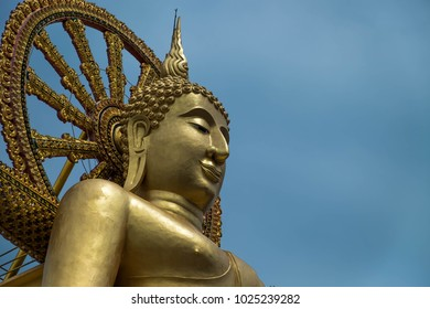 Big Golden Buddha Statue with Blue Sky In the background