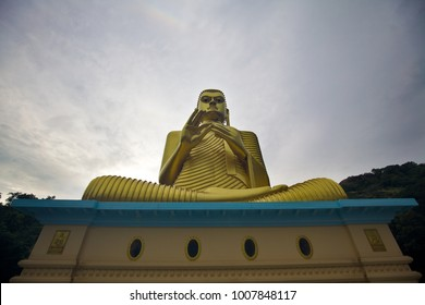 Big golden Buddha statue on the top of Golden cave temple in Dambulla, Sri Lanka
