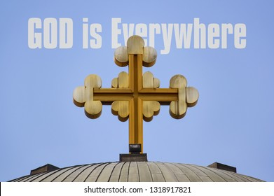 Big golden cross on the roof of a church and text God is Everywhere