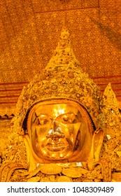 Big golden holy Mahamuni Buddha Image in Buddhist Temple at Mandalay, Myanmar