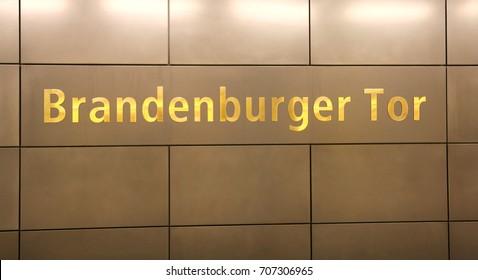 Big Golden inscription Brandenburger Tor in the wall in Berlin Germany that means Brandenburg Gate
