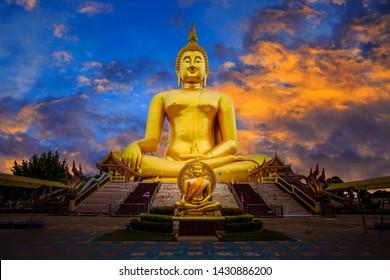 Big golden sitting Buddha at Wat Muang temple ,Phra Buddha Maha Nawamin and Mahaminh Sakayamunee Visejchaicharn.Ang Thong,Thailand.Makhabucha day,Visakha bucha day,Asarnha bucha day,Buddhist lent day.