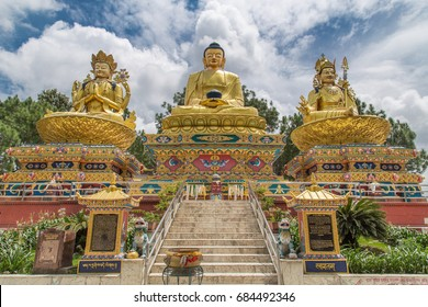 Big golden statues of Avalokiteshvara, Buddha Shakyamuni and Padmasambhava on lotus thrones in Buddha park, Swayambhunath area, Kathmandu, Nepal
