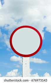Big gray blank on nature background, Beautiful sign and empty space, Traffic circular or circle sign and free space for text or symbol on blue sky or natural background, Actual lighting conditions