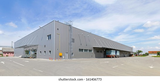Big gray distribution warehouse building