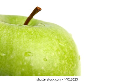 big green apple close up. It is isolated. White background.