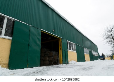 Big green distribution warehouse building of secondary raw materials