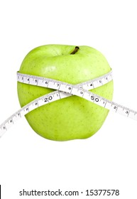 big green isolated apple with a measuring tape around it.