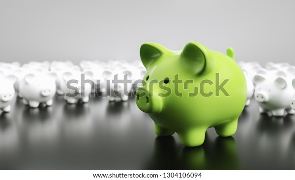 Big green piggy bank with small white piggy banks on a table