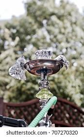 Big green sisha pipe in the garden. Outdoor relax concept.