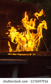 Big grill with a charcoal pile starting to burn