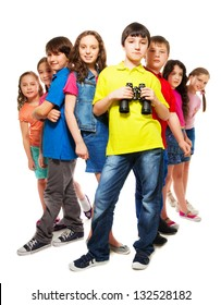 Big group of kids with confident boy holding binoculars