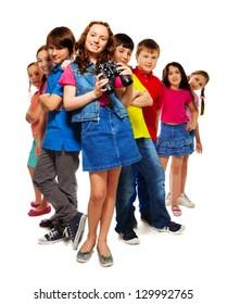 Big group of kids with girl holding binoculars
