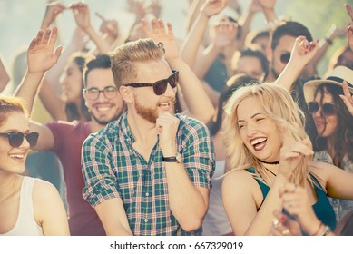 Big group of people dancing and having a good time at music festival